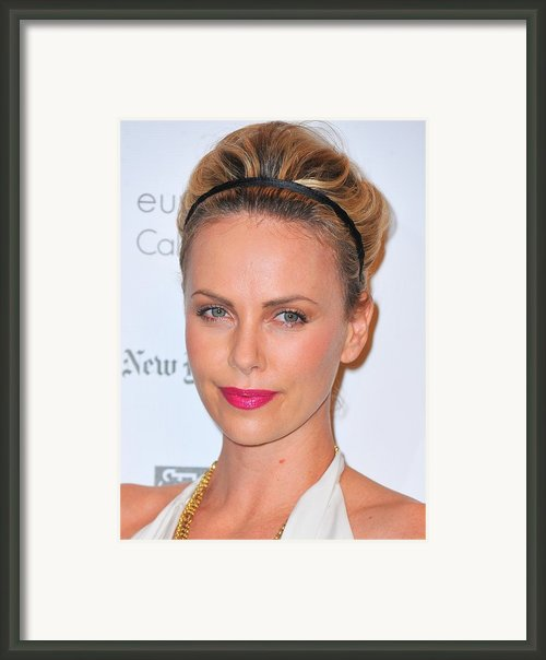 Charlize Theron Wearing A Jennifer Behr Framed Print By Everett