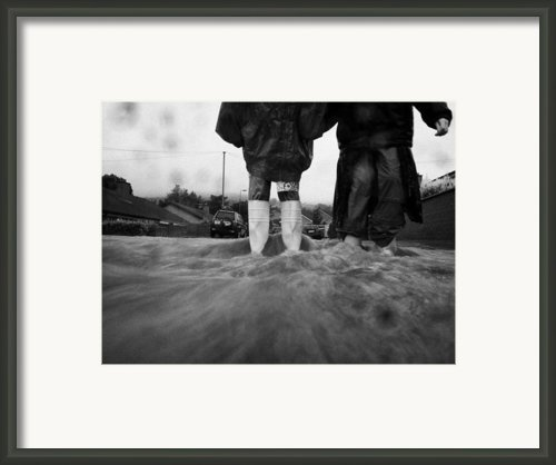 Children Walking In Heavy Rain Storm In The Street Framed Print By Joe Fox