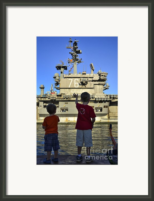 Children Wave As Uss Ronald Reagan Framed Print By Stocktrek Images