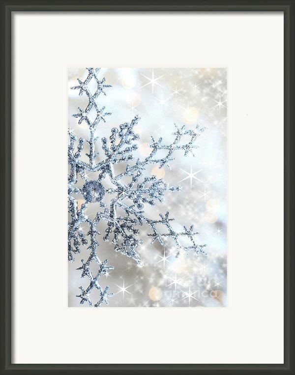 Closeup Of Snowflake Framed Print By Sandra Cunningham