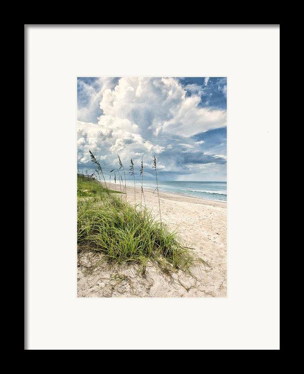 Clouds Over The Ocean Framed Print By Cheryl Davis