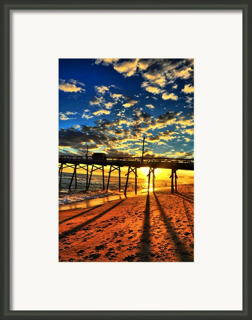 Clouds To The Pier Framed Print By Emily Stauring