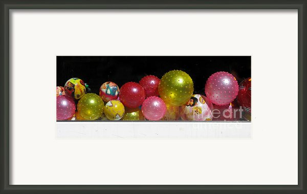 Colorful Balls In The Shop Window Framed Print By Ausra Paulauskaite