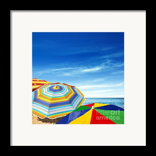Colorful Sunshades Framed Print By Carlos Caetano