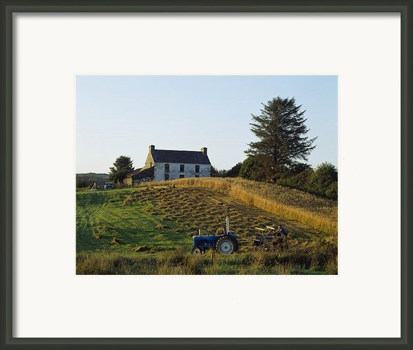 County Cork, Ireland Farmer On Tractor Framed Print By Ken Welsh