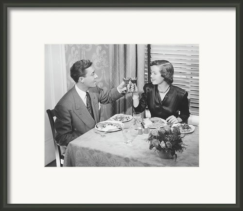 Couple Toasting At Dinner Table, (b&w), Elevated View Framed Print By George Marks