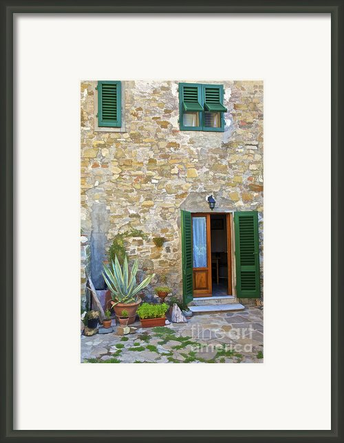Courtyard Of Tuscany Framed Print By David Letts