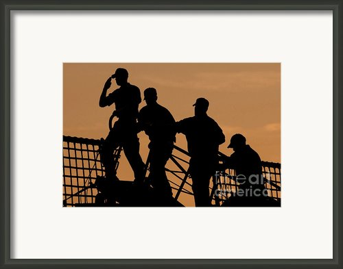 Crewmen Salute The American Flag Framed Print By Stocktrek Images