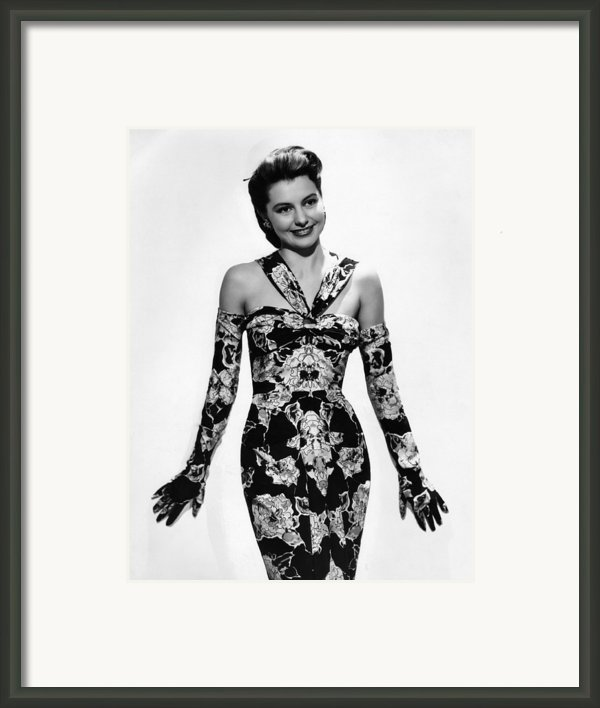 Cyd Charisse Modeling Flowered Evening Framed Print By Everett