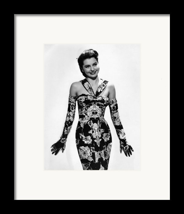 Cyd Charisse Modeling Flowered Evening Framed Print By Everett