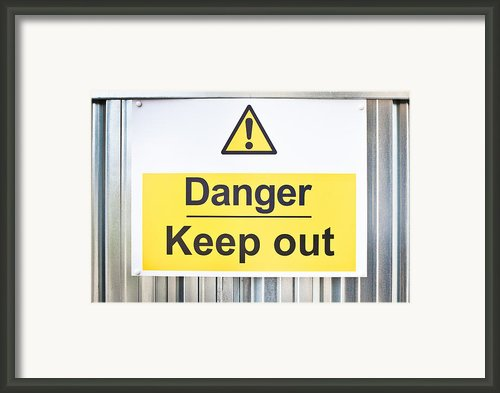 Danger Sign Framed Print By Tom Gowanlock