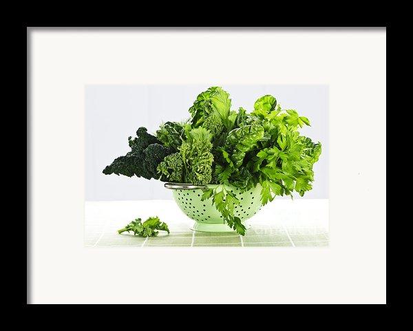 Dark Green Leafy Vegetables In Colander Framed Print By Elena Elisseeva
