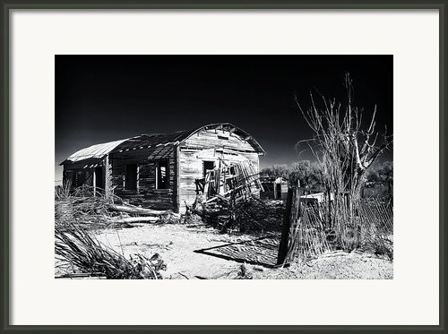Deserted In The Desert  Framed Print By John Rizzuto