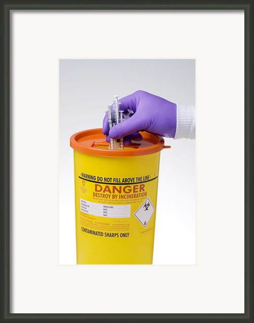 Disposal Of Contaminated Sharps Framed Print By Paul Rapson
