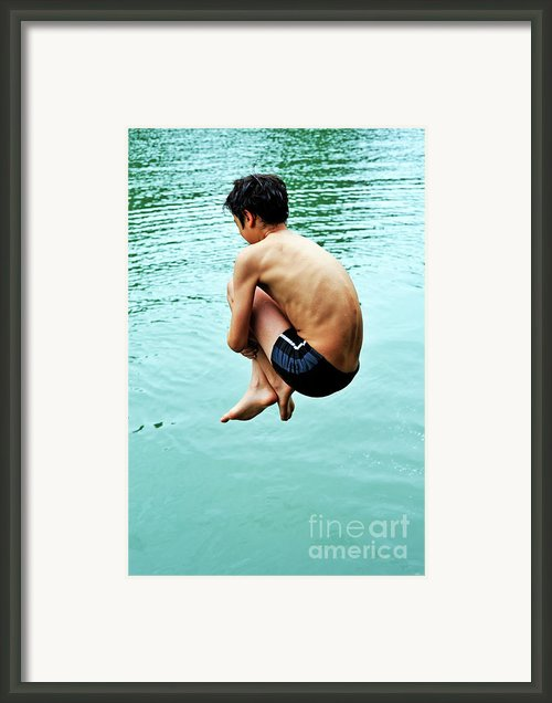 Diving Into Water Framed Print By Sami Sarkis