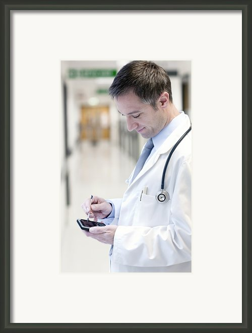 Doctor Using A Smart Phone Framed Print By