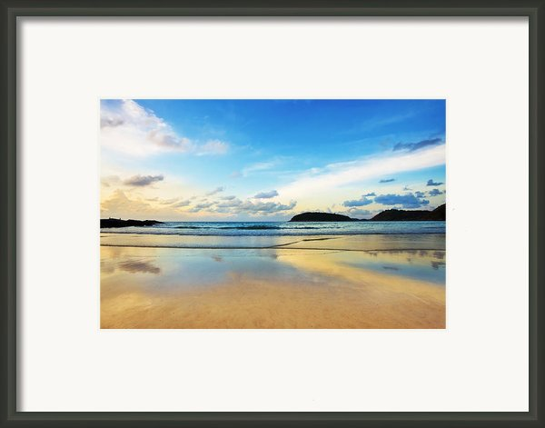 Dramatic Scene Of Sunset On The Beach Framed Print By Setsiri Silapasuwanchai