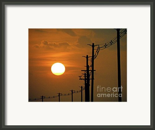 Dusk With Poles Framed Print By Joe Jake Pratt