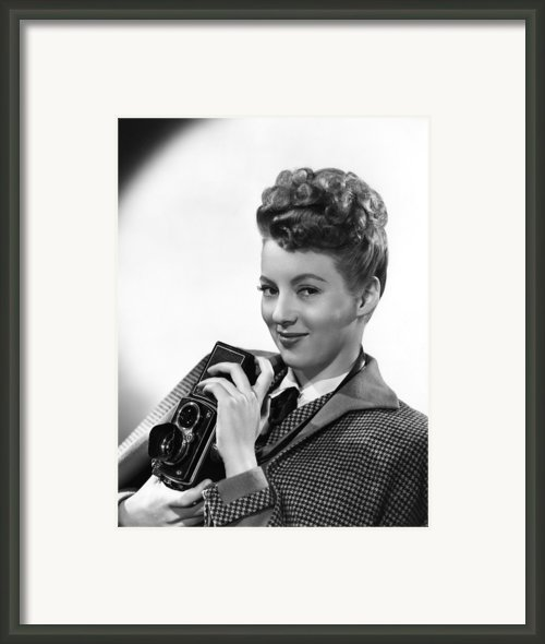 Evelyn Keyes, With A Rolex Camera, Ca Framed Print By Everett