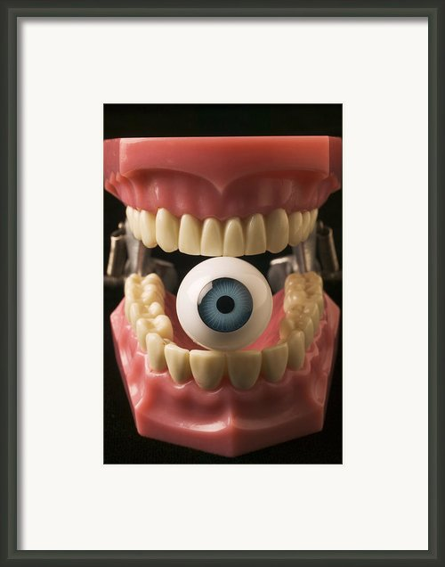 Eye Held By Teeth Framed Print By Garry Gay