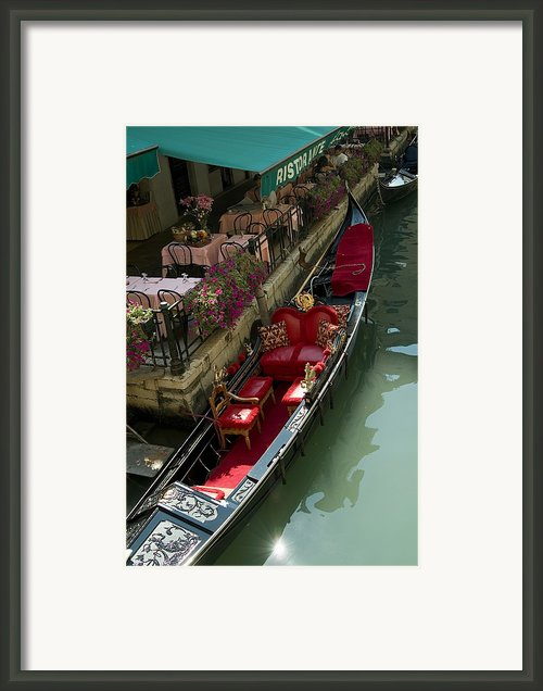 Fancy Gondola Parked In A Canal Next Framed Print By Todd Gipstein