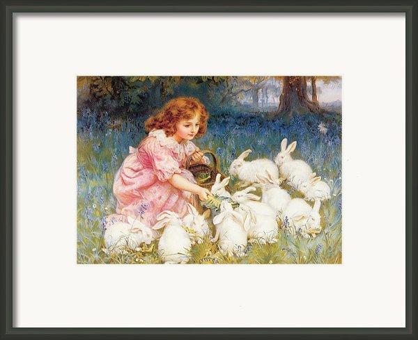 Feeding The Rabbits Framed Print By Frederick Morgan