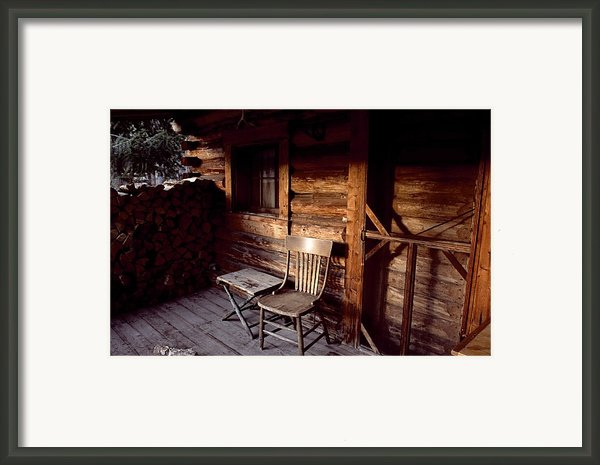 Firewood And A Chair On The Porch Framed Print By Joel Sartore