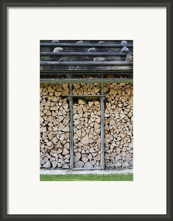 Firewood Stack Framed Print By Frank Tschakert
