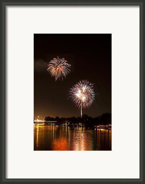 Fireworks Over A River Framed Print By Ulrich Schade