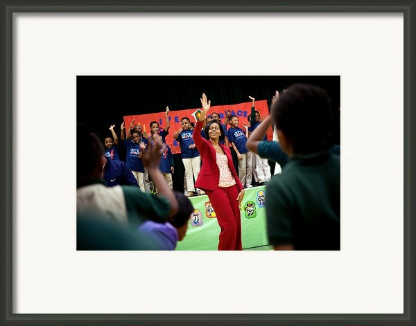 First Lady Michelle Obama Exercises Framed Print By Everett