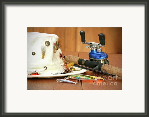 Fishing Reel With Hat And Color Lures Framed Print By Sandra Cunningham