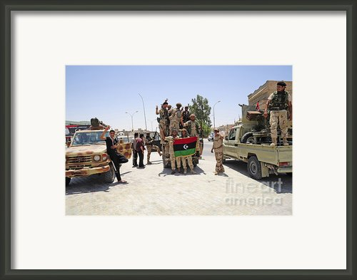 Free Libyan Army Troops Pose Framed Print By Andrew Chittock