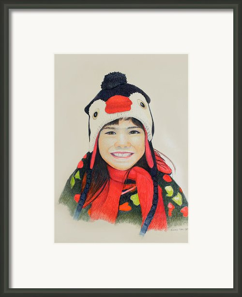Girl In The Penguin Cap Framed Print By Tim Ernst