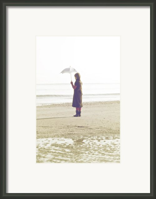 Girl On The Beach With Umbrella Framed Print By Joana Kruse