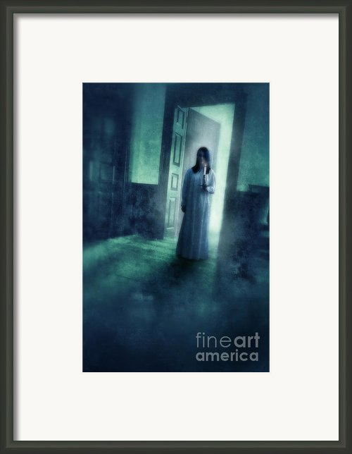 Girl With Candle In Doorway Framed Print By Jill Battaglia