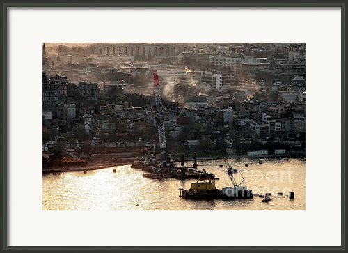 Golden Haze In Istanbul Framed Print By John Rizzuto