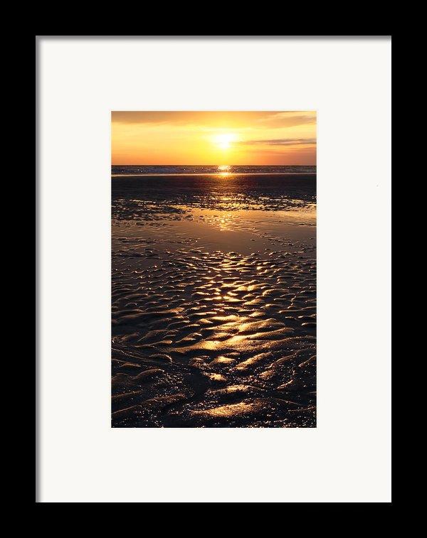 Golden Sunset On The Sand Beach Framed Print By Setsiri Silapasuwanchai