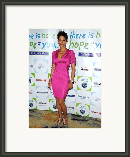 Halle Berry Wearing A Dress By Roberto Framed Print By Everett