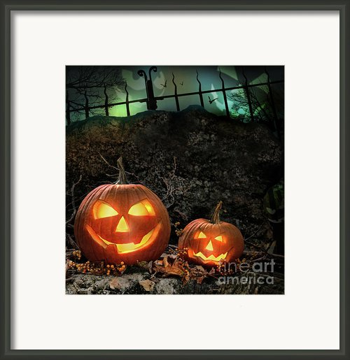 Halloween Pumpkins On Rocks  At Night Framed Print By Sandra Cunningham