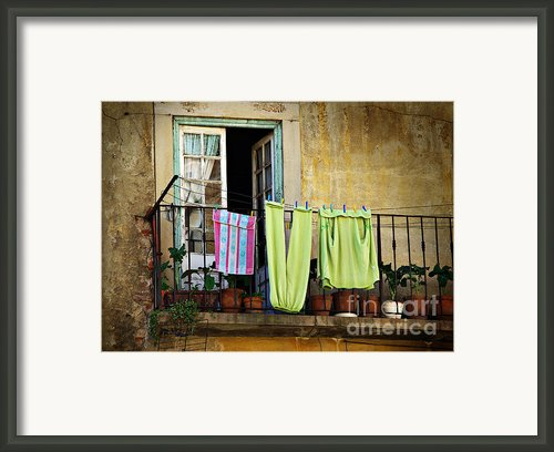 Hanged Clothes Framed Print By Carlos Caetano