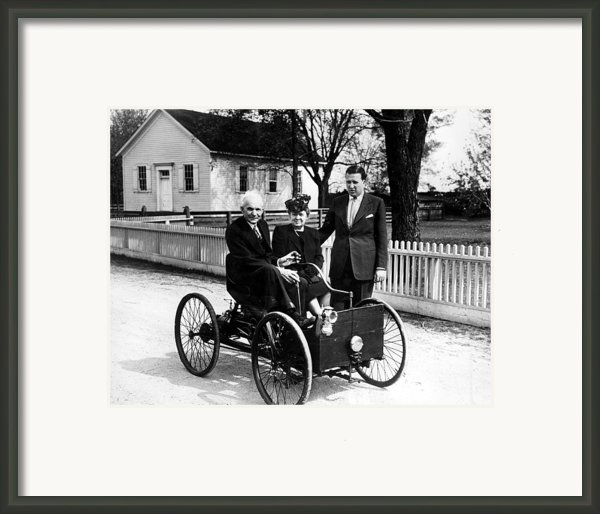 Henry Ford In His First Automobile Framed Print By Everett