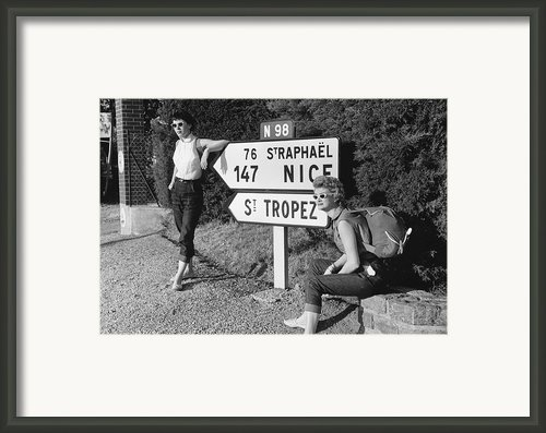 Hitch-hiking Framed Print By Maurice Ambler