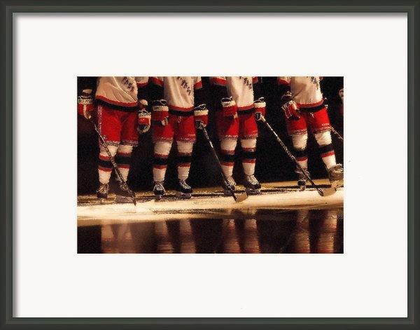 Hockey Reflection Framed Print By Karol  Livote