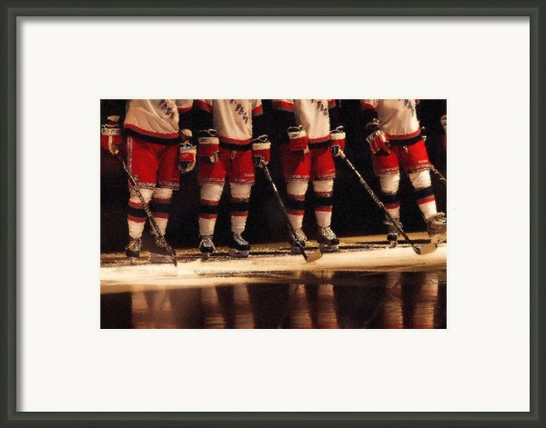 Hockey Reflection Framed Print By Karol  Livote
