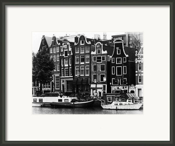 Homes Of Amsterdam Framed Print By Leslie Leda