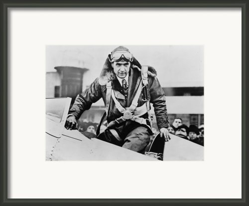 Howard Hughes Emerging From An Airplane Framed Print By Everett