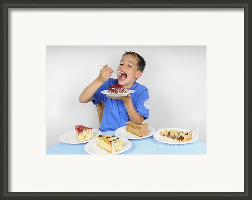 Hungry Boy Eating Lot Of Cake Framed Print By Matthias Hauser
