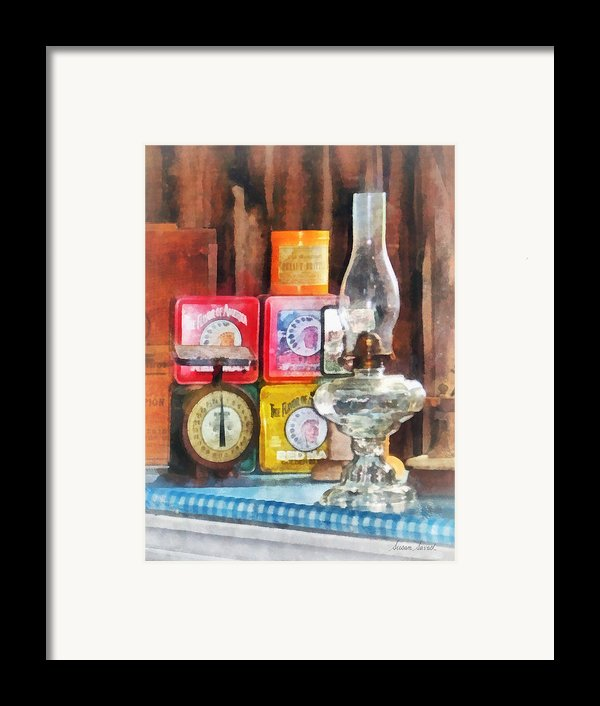 Hurricane Lamp And Scale Framed Print By Susan Savad
