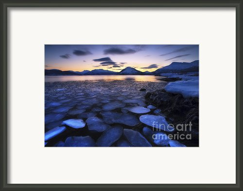 Ice Flakes Drifting Against The Sunset Framed Print By Arild Heitmann