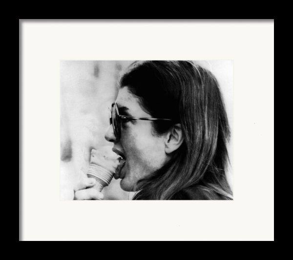 Jacqueline Kennedy Onassis Licks An Ice Framed Print By Everett